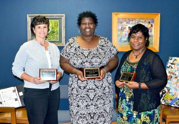 The October employees of the month were announced during Thursday's St. Mary Parish School Board meeting. They are, from left, Yvette Lake, civics teacher at Berwick High School; Constance Hawkins, cafeteria manager at J.A. Hernandez Elementary; and Agnes Lee, math teacher at B.E. Boudreaux Middle.