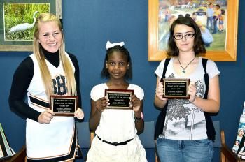 The October students of the month were announced during Thursday's St. Mary Parish School Board meeting. They are, from left, Sarah Carpenter, 12th-grader at Berwick High School; Tera Williams, fifth-grader at J.A. Hernandez Elementary; and Brianna Persilver, eighth-grader at B.E. Boudreaux Middle.