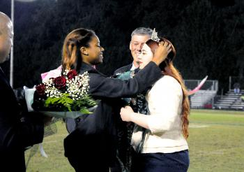 Nicole Perri was crowned Morgan City High School's 2013 homecoming queen during Friday's football game against Ellender. From left are Principal Mickey Fabre; 2012 queen Ariel Trimm; Perri's father, Tim Spiese; and Perri.
