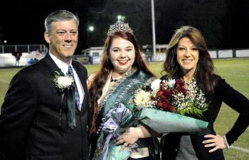 Morgan City High School's homecoming queen was presented by her parents during Friday's football game against Ellender. From left are her father, Tim Spiese; queen Nicole Perri; and mother, Christine Spiese.