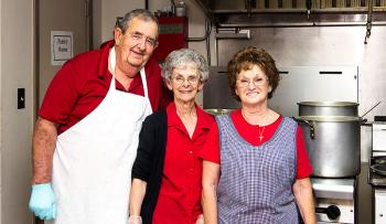 St. Mary AARP members preparing the meeting meal were, from left, Mac and Myrt McNemar, and Pat Fryer.