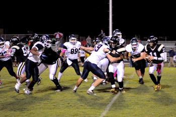 Berwick's Bobby Boudreaux, right, runs for yardage behind his blockers, continuing left, Jeremy Boudreaux, TyVon Batiste and Blake Bergeron, during last week's contest against Lafayette Christian. Boudreaux leads the Panthers in rushing and passing this season. The squad will return to District 9-3A action Friday when it hosts Donaldsonville.