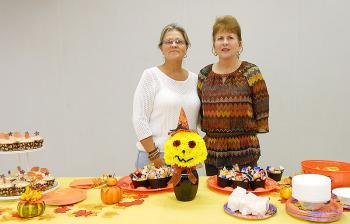 "Crystal Marcel and Nancy Marcel, from left respectively, were hostesses for Bayou Vista Garden Club's October meeting. Marcel created the floral design titled, ""Good Witch of the South,"" in keeping with the Halloween theme."