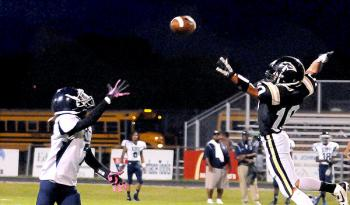 Berwick High School's Braden Billiot tries to deflect a pass away from a KIPP Renaissance player during the Panthers' 7-0 homecoming
