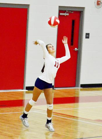 Central Catholic's Megan Landry serves against Houma Christian.