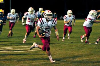 Central Catholic's Stefano Guarisco runs downfield while teammates, from left, Kyle Autin, Eriq Blanchard, Blake Hidalgo and Joe Michel are among those following him. Guarisco had 119 yards rushing, two second-half touchdowns and picked off a pass to help the Eagles defeat Hanson Memorial for Central Catholic's first win of the season. Blanchard also rushed for 101 yards in the victory.