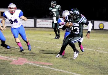 Morgan City's Jaylen Jones makes a return during the Tigers' contest with Ellender Friday. Jones, back after sitting out a few weeks due to an injury, tossed two touchdowns in the double overtime contest, but Morgan City fell to Ellender 34-32 after a failed two-point conversion pass.