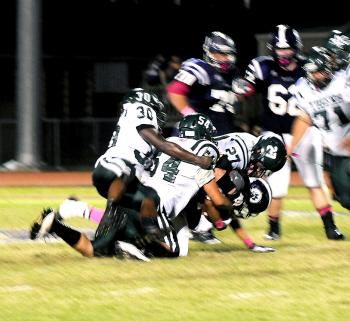 Morgan City's Dezin Young(No. 30), Bryce Reed (No. 54) and Dakota McCloy bring down a Rayne player during Friday's 36-0 contest. While Morgan City surrendered 373 yards of total offense, its defense continued to play well despite being on the field for quite a bit of time during the contest. Morgan City will open District 7-4A play Friday when it hosts Ellender for homecoming.