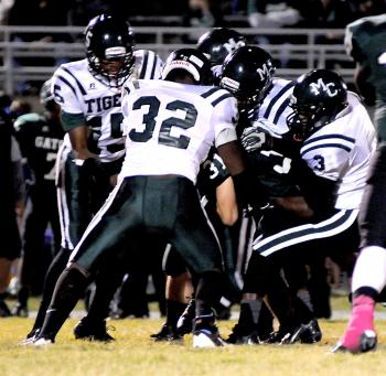 Morgan City players corral a South Terrebonne ball carrier during Friday's contest. The Tigers put up more than 200 yards of offense in the second half but could not overcome the Gators. Morgan City will continue district play Friday when it hosts Vandebilt Catholic.