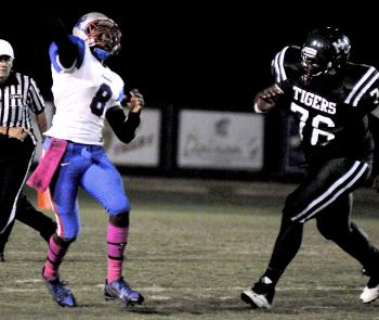 Morgan City's Daryl Johnson, right, pressures Ellender quarterback Curtis Anderson during the squads' District 7-4A contest in Morgan City last Friday. Morgan City will travel to face South Terrebonne Friday in district action in Bourg.