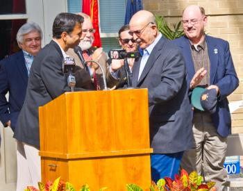 Gov. Bobby Jindal, front left, introduced former Gov. Mike Foster, right, during a kickoff of the planned construction of a $2 million renovation of the third floor of Franklin City Hall as an archives of Foster's political career as well as other state and federal elected officials from the Franklin area. Below is Jindal at the podium with mayors Wayne Breaux of Baldwin and Raymond Harris of Franklin standing behind him along with other guests, and seated are Sen. Bret Allain, Rep. Sam Jones and Foster.
