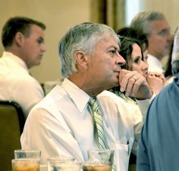 St. Mary Parish Levee District Executive Director Tim Matte listens while Jerome Zeringue, executive director of the Louisiana Coastal Protection and Restoration Authority, speaks during the St. Mary Industrial Group's meeting Monday.