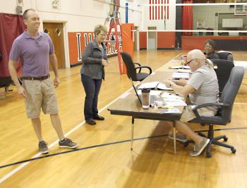 Voters approved a 20-year, $21 million bond issue to build a new Patterson Junior High School in Saturday's election. The vote will also add a multi-purpose building to Hattie Watts Elementary. From left are voter Doug Streety Jr. and commissioners Maureen Loudermilk, Richard Brinlee and Pearly Lightfoot. Also a commissioner, but not pictured, was Connie Escort.
